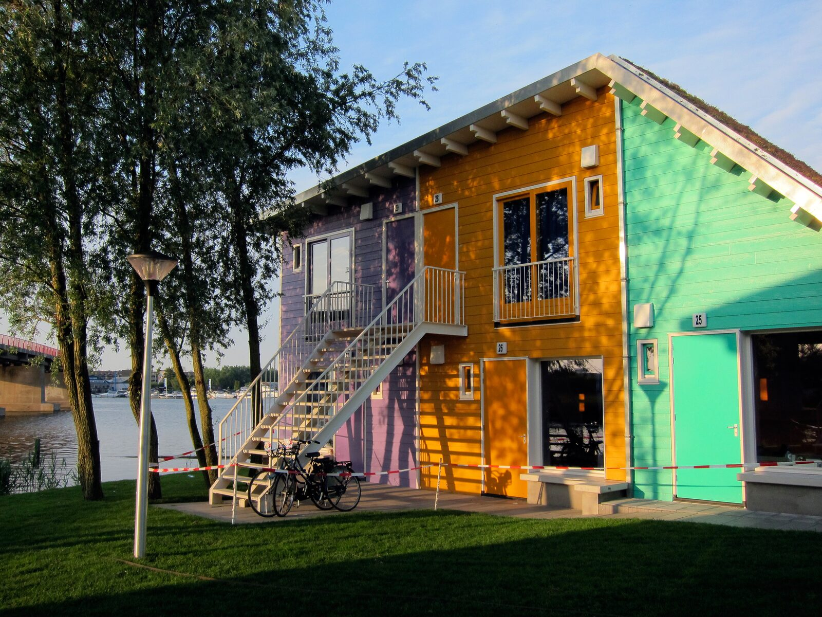 A two-person and a four-person Eco Cabin above each other on the waterfront