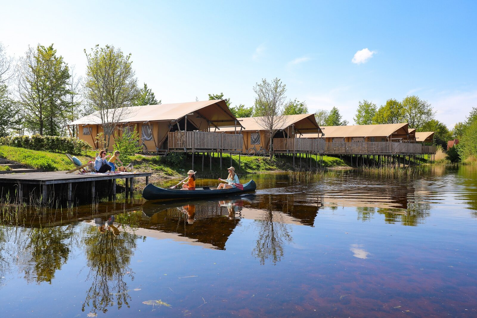Group accommodation: group tent + four 6-person luxury glamping tents (24 people)