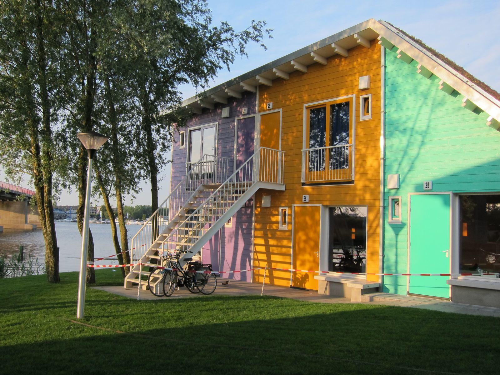 A two-person and a four-person Eco Cabin above the other on the waterfront